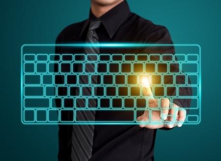 Business man pressing virtual type of keyboard