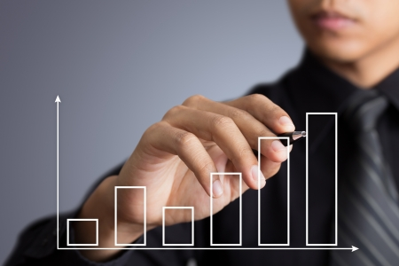Business man drawing a growth graph photo