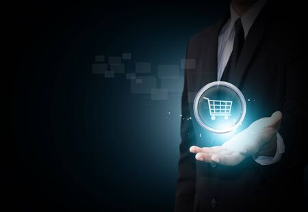 e retailers: Shopping cart icon in business hand Stock Photo