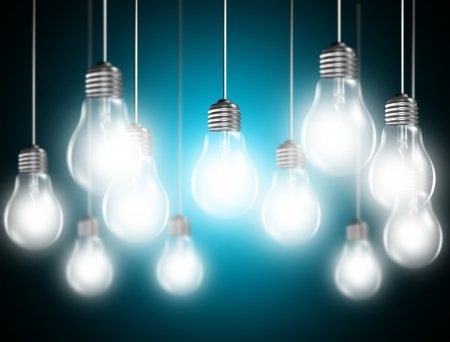 enchufe de luz: Bombillas de luz sobre fondo azul