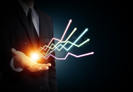 Hand holding a rising arrow, representing business growth
