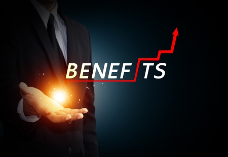 benefits: Business hand holding word benefits Stock Photo