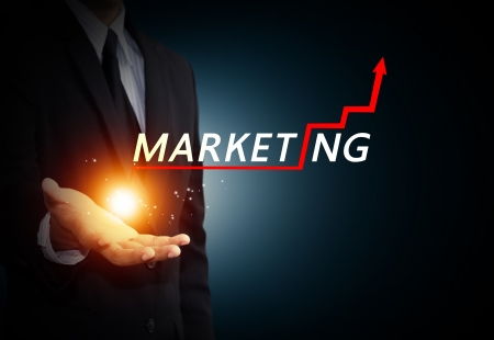 marketing plan: Hand holding a rising arrow, representing business growth