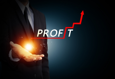 profitability: Hand holding a rising arrow, representing business growth