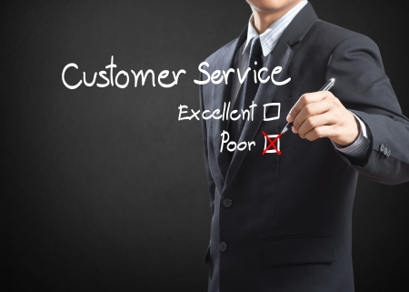 Hand putting check mark on poor customer service evaluation form photo