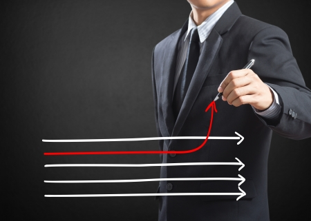 different strategy: Businessman drawing arrows in different directions