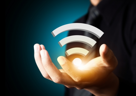 Wifi 技術記号のビジネスマンの手で、社会的ネットワークの概念 写真素材