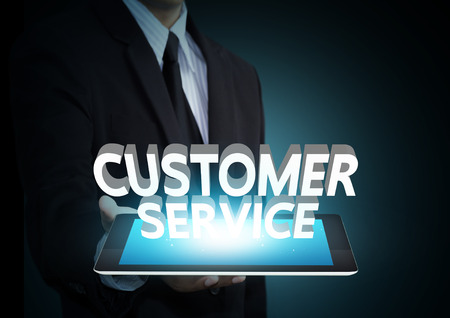 client service: Customer service 3D text on touch screen tablet technology, business concept