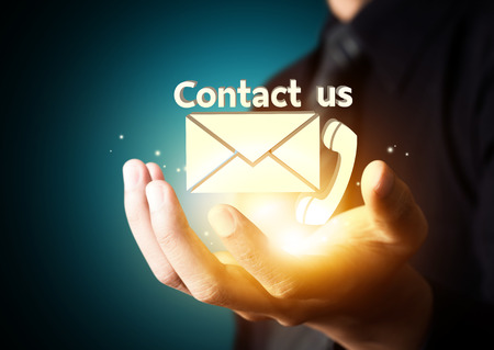 Contact us symbol in businessman hand, Email icon Stock Photo