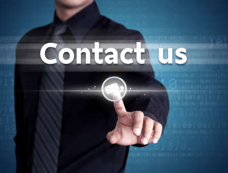 Businessman hand pushing contact us button on a touch screen interface, technology concept photo