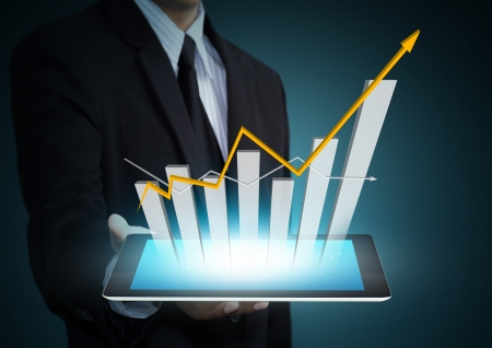 document management: Business hand holding growth chart on tablet technology