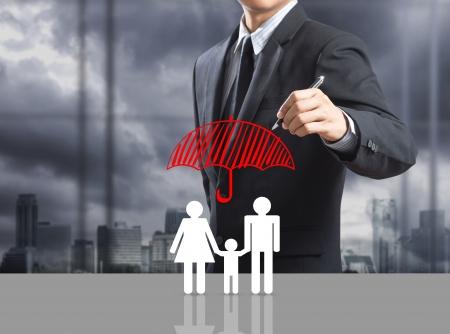 ビジネス男図面保険コンセプト 写真素材