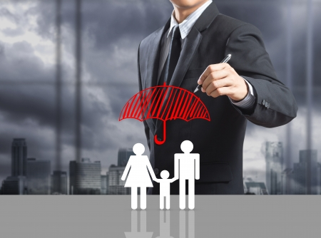 protect family: Business man drawing insurance concept