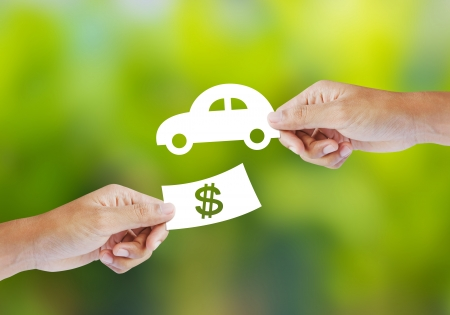 Hand with paper money and car shape  new car buy concept Archivio Fotografico