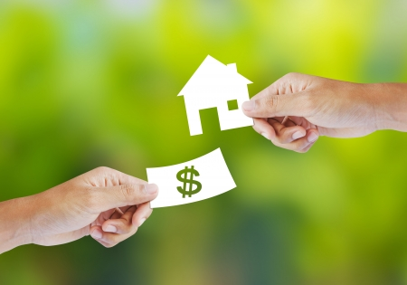mortgage: Hand with paper money and house shape