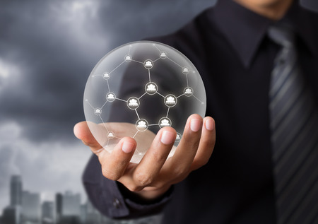 crystal ball: Business people holding social network in crystal ball