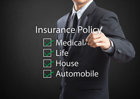 Business man writing life insurance policy