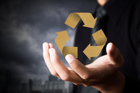 hand holding globe: Paper recycle sign in business man hand Stock Photo