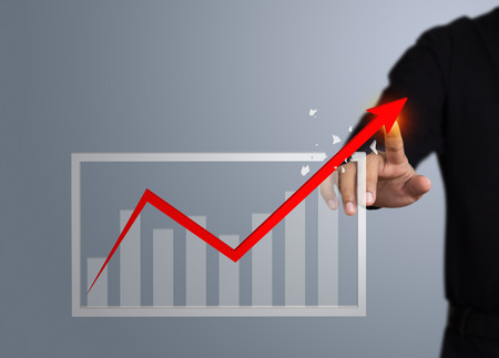 Businessman touching a rising arrow, Business growth concept 写真素材