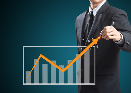 Businessman drawing a rising arrow, Business growth concept