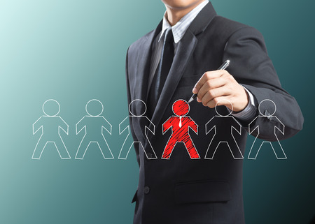 Business man drawing leadership concept, Think different