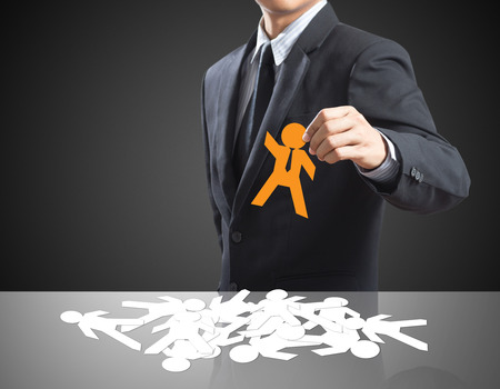 Human resources officer choose employee standing out of the crowd  Leadership concept Stock Photo