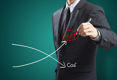 downward: Business man drawing graph of profit compare with cost Stock Photo