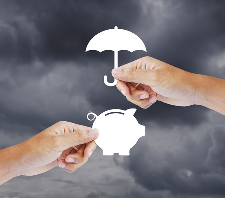 Hand holding a paper  piggy bank and umbrella, Insurance concept photo
