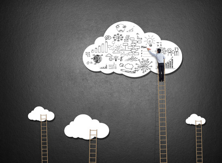 Businessman climbing ladder drawing idea on cloud