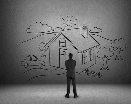 Businessman draw a house on wall, Dream home photo