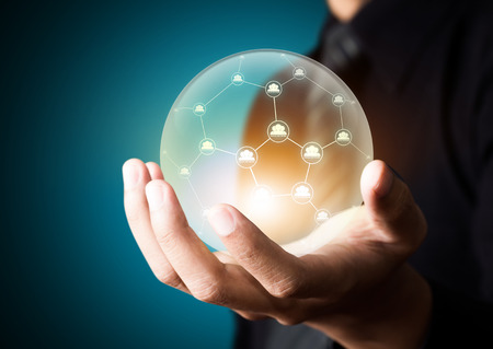 business networking: Business people holding social network in crystal ball