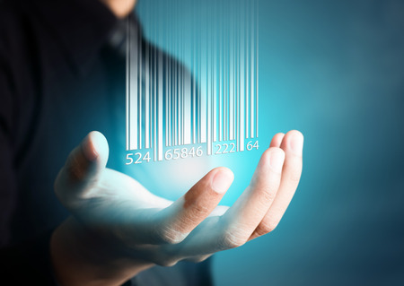 Barcode dropping on businessman hand, financial concept