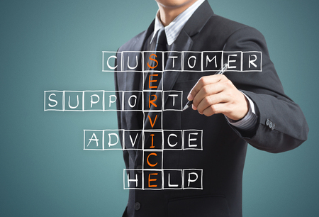 customer care: Business man writing customer service concept Stock Photo