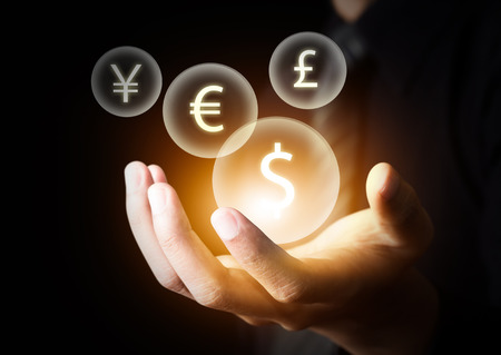 foreign currency: International currencies on businessman Stock Photo