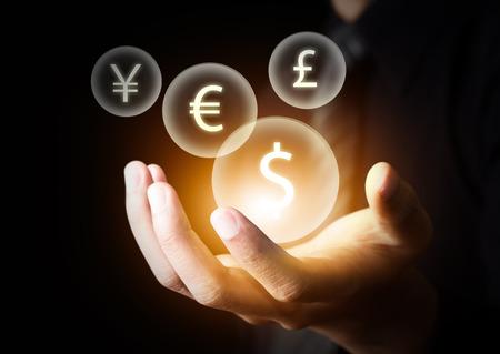 International currencies on businessman Stockfoto
