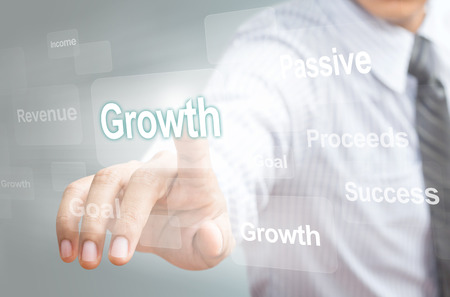 Business man pointing growth concept on touchsreen photo