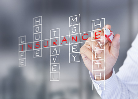 financial symbols: Businessman write life insurance, house insurance, home insurance, travel insurance, health insurance