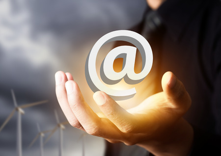 email contact: Email icon in businessman hand, contact us