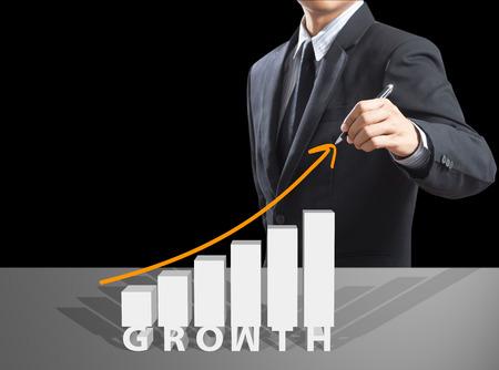 Business man drawing growth chart, success concept Foto de archivo
