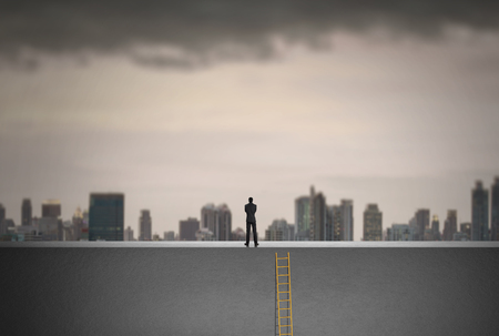 looking ahead: Businessman climbing on a ladder over a city looking ahead, Leadership concept