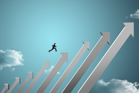 going: businessman jumping on growing chart with sky background Stock Photo
