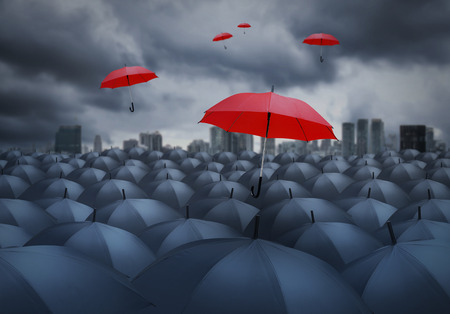 red umbrella outstanding from the others