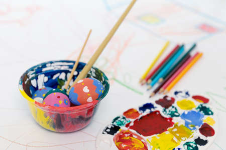 pencils  clutter: Easter egg painting Stock Photo