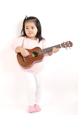 thai musical instrument: Asian child playing ukulele