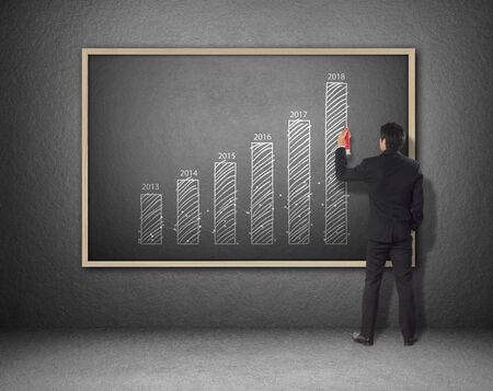 yoy: businessman drawing increasing graph, year over year, YOY Stock Photo