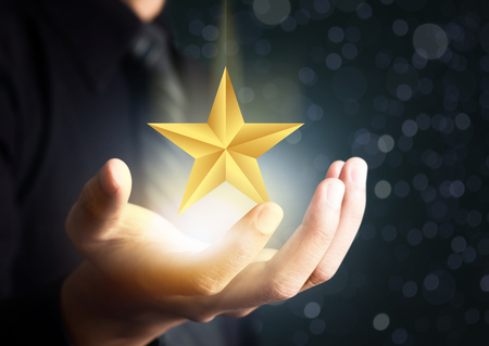 businessman holding excellence star Stok Fotoğraf - 82880624
