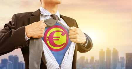 businessman in superhero costume with Euro currency and city background