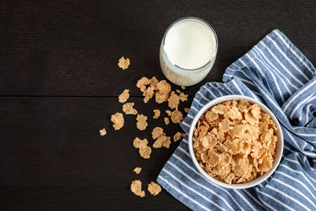 Healthy Corn Flakes with milk for Breakfast on table Stock Photo
