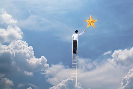businessman climb up on ladder to reach star, successful and win concept Stock fotó