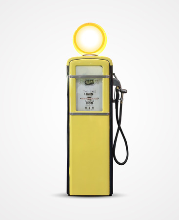 Old vintage gasoline petrol pump isolated on plain